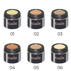 Babor AGE ID Camouflage Cream er en kamuflasjekrem i 6 nyanser som dekker medfødte eller ervervede ujevnheter i huden som pigmentmerker, synlige årer, tatoveringer og portvinsflekker.